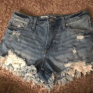 Distressed shorts with lace detail